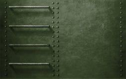 Зеленая предпосылка стороны военного транспортного средства металла Стоковые Фотографии RF