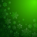Зеленая предпосылка с снежинками, Стоковые Изображения
