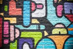 Зеленая розовая предпосылка кирпичной стены голубого красного цвета оранжевая черная желтая Стоковое фото RF
