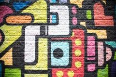 Зеленая розовая предпосылка кирпичной стены голубого красного цвета оранжевая черная желтая Стоковые Фото