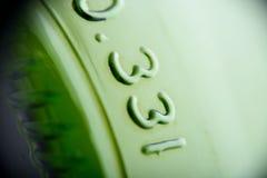 Зеленая съемка макроса дна пивной бутылки Стоковая Фотография RF