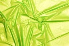 Зеленая текстура полиэтиленового пакета, предпосылка Стоковое фото RF