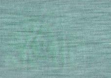 Зеленая текстура ткани джинсов Стоковые Изображения RF