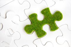 Зеленая часть головоломки Стоковое Изображение RF