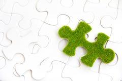 Зеленая часть головоломки Стоковые Изображения