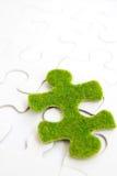 Зеленая часть головоломки Стоковое Фото