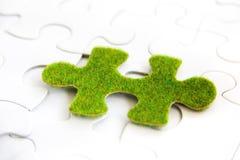 Зеленая часть головоломки Стоковые Изображения RF
