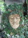 Зеленое естественное обрамило скульптуру Стоковое Фото