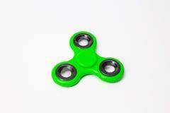 Зеленое изображение игрушки обтекателя втулки пальца непоседы стоковые фото