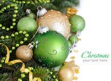 Зеленое и золотое рождество орнаментирует границу Стоковые Фото