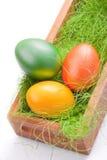 Зеленое и померанцовое пасхальное яйцо Стоковые Фотографии RF