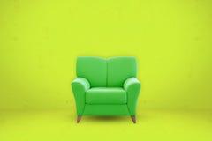 Зеленое место софы на зеленой предпосылке комнаты Стоковое Фото
