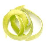 Зеленое шелушение Яблока с белизной, концом вверх по съемке Стоковые Изображения RF