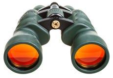 Зеленые бинокли при оранжевые изолированные стекла Стоковые Изображения RF