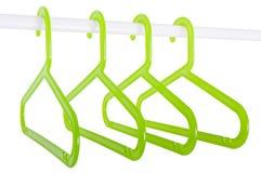 Зеленые вешалки на штанге изолированной на белизне Стоковое фото RF