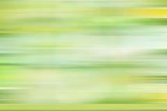Зеленые желтые линии нерезкости движения предпосылки градиента Стоковые Фото