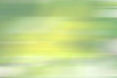 Зеленые желтые линии нерезкости движения предпосылки градиента Стоковое фото RF