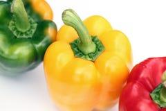 Зеленые, желтые и красные перцы Стоковые Изображения RF