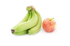 Зеленые зрелые банан и яблоко Стоковое Изображение RF