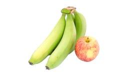 Зеленые зрелые банан и яблоко Стоковое Фото