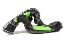 Зеленые и черные перчатки бокса Стоковое Фото