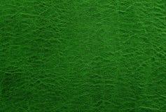 Зеленые кожаные предпосылка или текстура Аннотация Стоковая Фотография