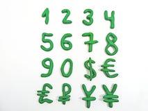 Зеленые номера и валюта денег Стоковое Изображение