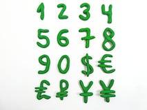 Зеленые номера и валюта денег Стоковое Изображение RF