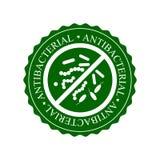 Зеленые противобактериологические значок, значок или ярлык изолированные на белой предпосылке Стоковое фото RF