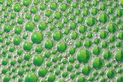 Зеленые пузыри воды мыла блюда Стоковое Фото