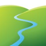 Зеленые холмы и голубое река Стоковое Фото