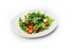 Зеленые цвета салата и томаты вишни Стоковые Фото