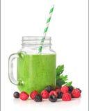 Зеленые smoothies в стеклянном опарнике Стоковое Фото