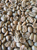 Зеленые unroasted кофейные зерна стоковые изображения