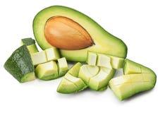 Зеленый авокадо при куски изолированные на белой предпосылке Стоковые Фотографии RF