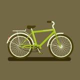 Зеленый велосипед на темной предпосылке Стоковые Фотографии RF