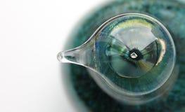 Зеленый глаз в стекле Стоковые Фото