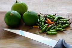 Зеленый лимон и пряный chili Стоковая Фотография