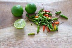 Зеленый лимон и пряный chili Стоковые Изображения RF