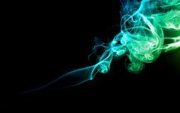 Зеленый и голубой дым на темноте Стоковое фото RF