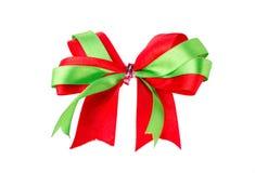 Зеленый и красный смычок подарка ленты сатинировки Стоковое фото RF