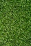 Зеленый крупный план текстуры дерновины футбольного поля Стоковая Фотография RF