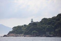 Зеленый маяк Compund острова на hk Стоковое фото RF