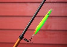 Зеленый неоновый удя крюк на рыболовной удочке Стоковые Изображения RF