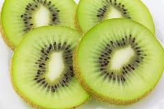 Зеленый отрезанный киви Стоковые Фото