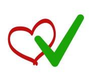 Зеленый проверенные знак тикания и красное сердце стоковое фото
