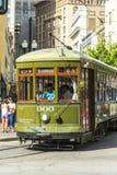 Зеленый трамвай вагонетки на рельсе Стоковые Фотографии RF