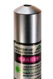 Зеленый указатель лазера при предупреждающий ярлык изолированный на белизне Стоковое Изображение
