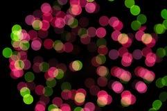 Зеленый цвет и пинк запачкают bokeh фокуса фейерверка Стоковое Фото