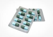 Зеленый цвет и свет - голубая капсула в прозрачном пакете волдыря Стоковые Фото
